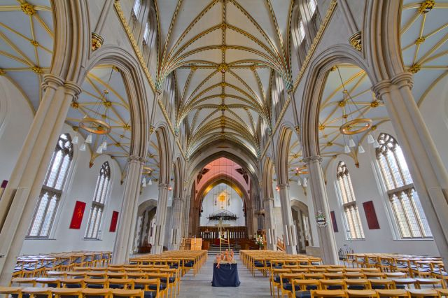 The nave at Blackburn Cathedral is the original parish church of 200 years ago, before the diocese was created due to urban growth during the Industrial Revolution. The interior is light, serving to lift the spirits of those who worship. (Michael Beckwith/Wikipedia)