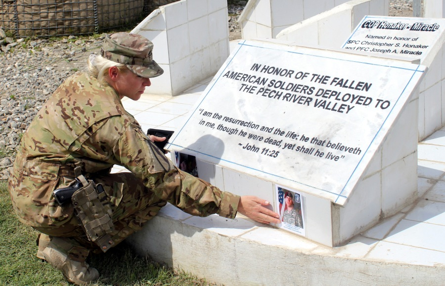 Staff Sgt. Charlene Navarette, a flight medic with the 1st Cavalry Division in Afghanistan, got to visit the Honaker-Miracle Memorial in the Pech Valley of Kunar Province last year and place a picture of her brother, Spc. Christopher Honaker, who was killed nearby along with Pfc. Joseph Miracle in July 2007. (SSgt. Joe Armas via Fort Hood Sentinel)