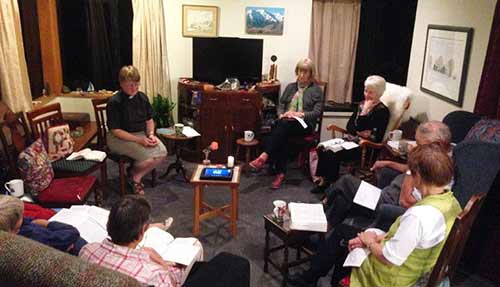 A Lenten prayer and study group meets in person and by Skype in Malvern Parish, New Zealand, much like we webcast Morning Prayer. A computer tablet is placed on the table in the center. Malvern Parish consists of churches in five local villages. (The Rev. Bosco Peters via Facebook)