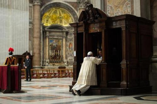 Pope Francis surprised everyone Friday at his regular public Mass at St. Peter's when, after preaching on the importance of confessing our sins, which was supposed to lead to his hearing the crowd's confessions with dozens of other priests, he darted off to the nearest one and showed how it's done. (L'Osservatore Romano via AP)