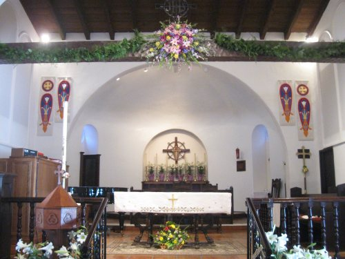 Easter 2014 at St. Clement's by the Sea, San Clemente, California. How do they get the flowers up on the beam overhead? Probably a clever altar guild directress. (Katrina Soto)