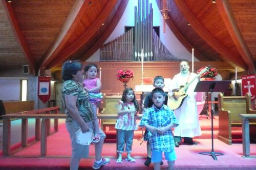 "To mark the birthdays of children at Iglesia Cristo Rey in Watsonville, California, the congregation sings ""Las Mañanitas,"" a popular Christian birthday song, accompanied by Padre Mickey Dresbach on guitar. (via Facebook)"