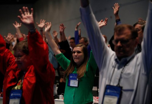 Delegates to the General Assembly of the Presbyterian Church (USA) overwhelmingly endorsed same-sex marriage Thursday, including hosting ceremonies blessed by ordained clergy who choose to officiate. A companion vote to change the terminology of marriage in the Book of Discipline also passed easily, but must be ratified by a majority of local presbyteries. (Joshua Lott/The New York Times)
