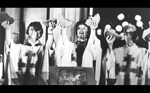 The Revs. Alison Cheek, Carter Heyward and Jeannette Piccard lift up the Body of Christ at one of their first public masses, at Riverside Church, New York, in October 1974. The Philadelphia 11 were basically shunned by every parish, diocese and bishop for two years until General Convention voted to approve the ordination of women - and the glass ceiling is still there today, despite the election of a woman, Katharine Jefferts Schori, as Presiding Bishop in 2006. (Chris Sheridan/Religion News Service)