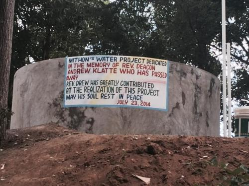 This is a memorial in Mithon, Haiti to the Rev. Andrew Klatte, a deacon and peacemaker in the Diocese of Indianapolis, who led mission efforts in the Diocese of Haiti, including the rebuilding of St. Andrew's School in Mithon. A delegation from Indianapolis, including Bishop Cate Waynick, is in Mithon now to dedicate the school in this mountain village, devastated by the 2010 earthquake. Drew died suddenly earlier this year, but he knew his work and friendships would live on. (Père Michelin St. Louis)