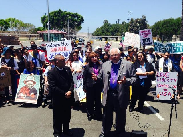 The Rt. Rev. Jon Bruno, Bishop of Los Angeles, called for a humanitarian response to the Central American children's refugee crisis this week, as human rights activists made their support known behind him. In the county east of Los Angeles, other demonstrators have angrily protested the arrival of children in the custody of the border patrol, which has run out of places to put them. (via Facebook)