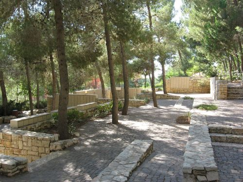 Garden of the Righteous Among the Nations at Yad Vashem in Jerusalem. Part of the Wall of Honor is visible, honoring about 25,000 Righteous Gentiles, each one of them carefully vetted. (Wikipedia)