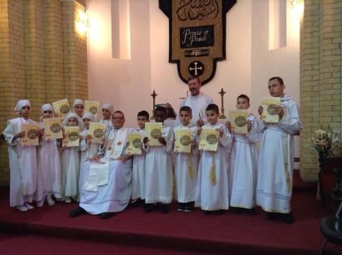 First Communion at St. George's, Baghdad, on Friday. The situation in Iraq is dire and deteriorating, as the Rev. Canon Andrew White reported one week ago (see his statement below), but still the church is able to maintain a faithful witness and raise up these children. He is seated in the front row. (Andrew White on Facebook)
