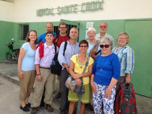 """Following daily in the blessed steps of Christ,"" as the Collect says, means to many people acts of mission like this: Bishop Cate Waynick and a delegation from the Diocese of Indianapolis during a stop at Holy Cross Hospital in Haiti, on their way last month to dedicating the new Episcopal school at Mithon. There's nothing particularly unusual or heroic about it, it's just part of the Christian life. What steps do you take on the Way? (Matthew Cole)"