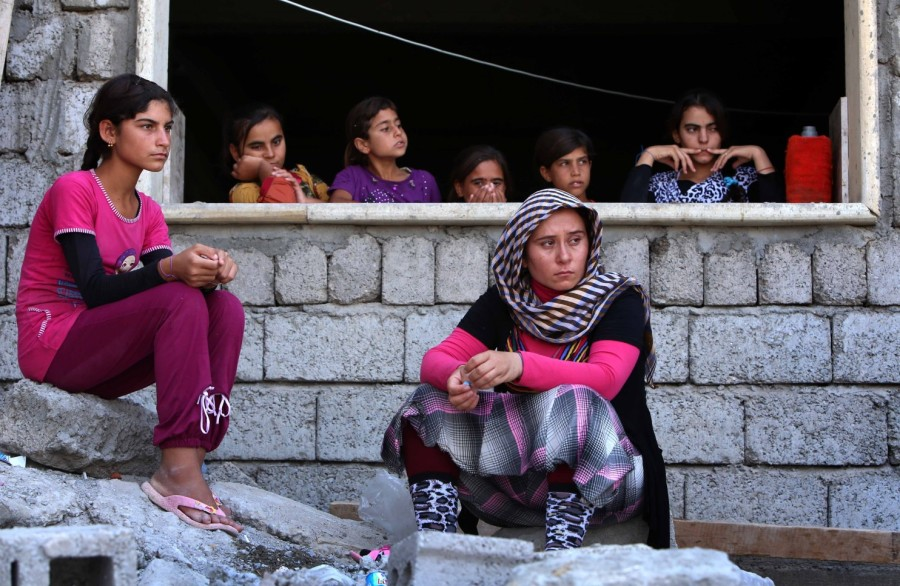 Let us begin with prayers for 40,000 Yazidi refugees, surrounded by ISIS in the Kurdistan province of northern Iraq. This long-persecuted minority practices a religion that combines Islam, Christianity and Zoroastrianism, which is apostasy to their brutal captors. The people have fled up a mountain and are now dying of thirst. (Photog/AFP-Getty)