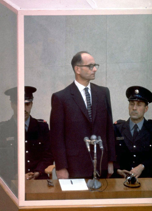 "Adolf Eichmann, the architect of the Holocaust, on trial in Jerusalem, 1961. Decades ago a famous book by Hannah Arendt tried to explain his mind and behavior as reflecting ""the banality of evil,"" but new research by Bettina Stangneth may finally have debunked that claim. She found that far from being a functioning robot, as he claimed, Eichmann believed fanatically in annihilating the Jews, and calculated his every move to bring it about – including how he would escape responsibility by hiding in Argentina and constructing a persona of mindless conformity. He may have fooled Arendt and confounded the world, but it didn't work in front of a judge; he was executed in 1962. (John Milli/Israeli Government Press Office)"
