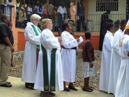Bishop Cate Waynick and Deacon Cathy Scott of the Diocese of Indianapolis at the dedication in late July of the new Episcopal school at Mithon, Haiti; it seemed like the whole community was there. (Matthew Cole)