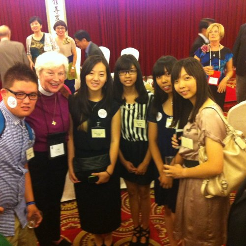 The Bishop of Indianapolis (and Episcopal Visitor of this site), the Rt. Rev. Catherine M. Waynick, reconnecting with some Taiwanese Christian kids she met a few months ago at EYE 14, the big Episcopal youth event in Philadelphia. (IndyDio on Facebook)