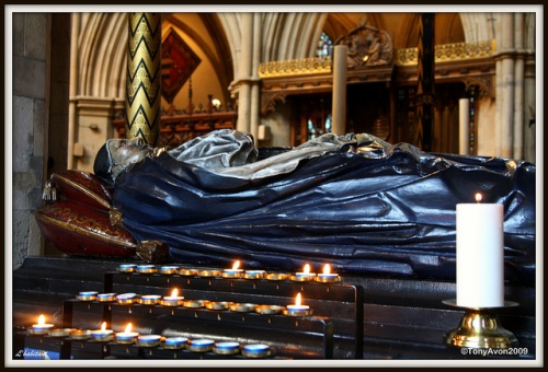 Tomb of Bishop Andrewes in Southwark Cathedral, England. Coming as he did a generation after the passions of the first Protesters and reformers, his views have been called a more mature form of theirs; he praised John Calvin's theology but never wavered in his belief in the Real Presence of Christ in the Sacrament. (Tony Avon on Flickr)