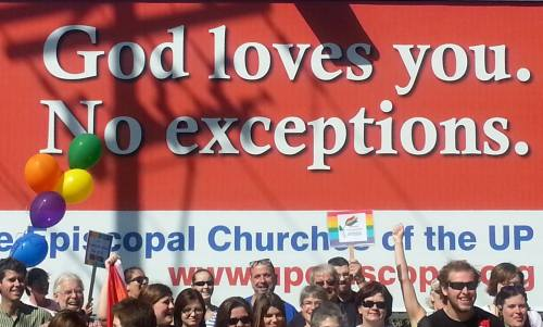 Marquette, Michigan, a small college town on Lake Superior, which forms the water boundary with Canada, held its first LGBT Pride Festival 7 September, and Episcopalians gathered in front of this billboard erected by their diocese for its evangelism campaign. (Rise Thew Forrester)