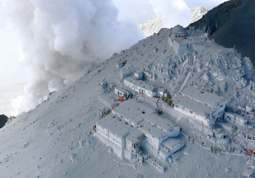 A resort on Mt. Ontake, Japan, suddenly covered in ash after the volcano erupted Saturday. Some 31 hikers are feared dead so far, with dozens more injured. (Kyodo News via Associated Press)