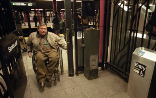 Terence Moakley, a staunch advocate of the rights of people with disabilities, has died in New York. He focused on public transportation, including subways, buses, taxis and sidewalks; two weeks after he died, a years-long lawsuit he championed against the city ended in a judgment forcing thousands of taxis to be wheelchair-accessible by 2020. (Librado Romero/The New York Times)