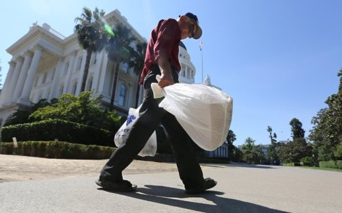 California has enacted a statewide ban on plastic grocery bags, to go into effect next year. Billions of them litter the landscape, choke waterways, kill wildlife and clog landfills, where they may never degrade. The most populous U.S. state joins China and several African nations in outlawing their use; some other countries tax them. (Rich Pedroncelli/Associated Press)