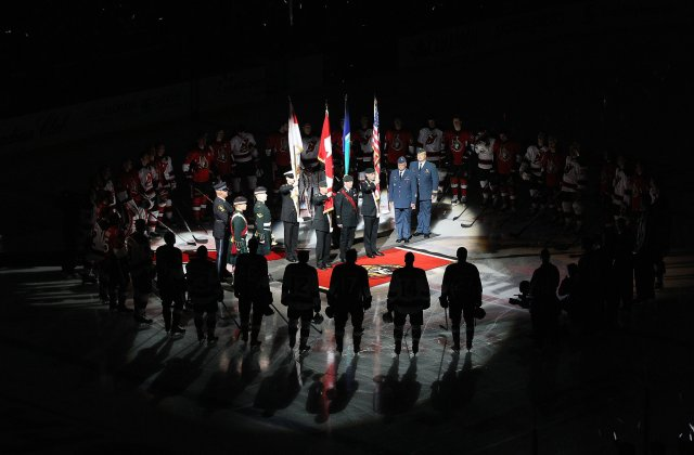 A color guard presented the Canadian flag at an Ottawa Senators hockey game Saturday night, a routine ceremony made suddenly poignant in remembrance of soldiers gunned down by apparent terrorists last week in Ottawa and Montréal. (Jana Chytilova/Freestyle Photo via Getty Images)