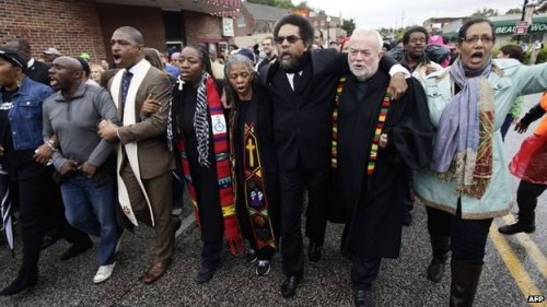 In the wake of two recent police shootings of young black men in the St. Louis area, clergy of many backgrounds marched for peace and social justice last week in #Ferguson, Missouri. The Rev. Prof. Cornel West, center, is controversial in the eyes of some on the right and the left – but what these ministers are trying to do is follow the directions in Ecclesiasticus: rescue the oppressed from the oppressor. (Agence France-Presse)