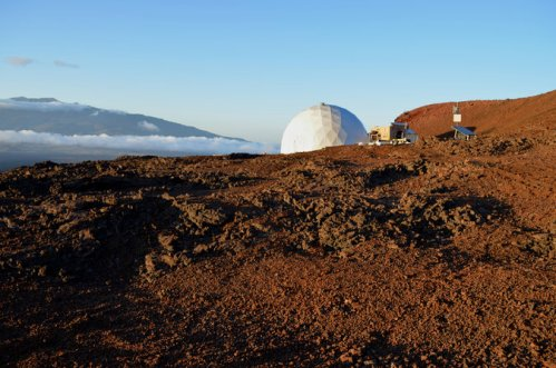"Six would-be astronauts are now living apart from humanity in this ""Hi-Seas"" dome atop the Mauna Loa volcano in Hawai'i as a simulated environment for a future mission to Mars. They will live together for 8 months, cut off from  contact with the world except for e-mail, which will be on a 20-minute delay to represent the lag time between Earth and the red planet. If an emergency occurs they'll be rescued, but otherwise they're on their own. If the Mars mission does occur sometime in the 2030s, the explorers will be gone for 2 1/2 years; a one-way trip lasts six months. (Sian Proctor/University of Hawai'i at Manoa)"