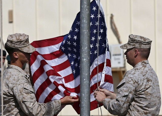 Troops lowered the American flag last weekend in Helmand Province, Afghanistan, signaling a sort of/not really U.S./British pullout after 13 years of war. After the official end next month, some 10,000 U.S. troops will remain for at least two more years. (Omar Sobhani/Reuters)