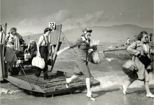 Red Cross women landing at Normandy, France, shortly after D-Day in 1944. The Allied invasion is known to all, but few people have heard that women were there too. Casualties were massive; of course nurses went to help.
