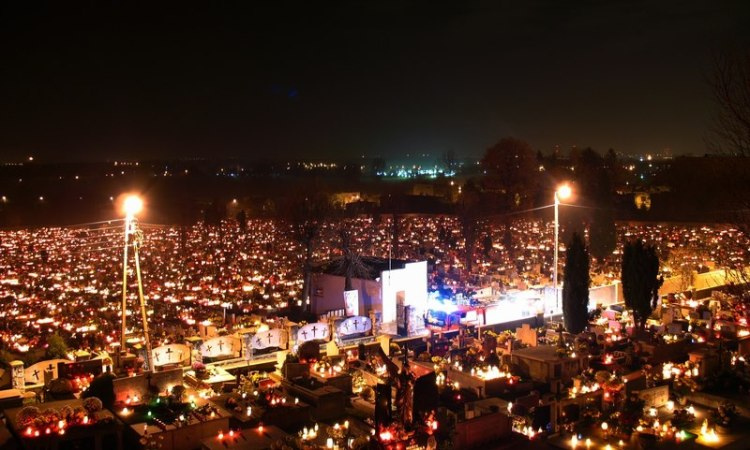 Gathering at a cemetery in Poland for All Saints' Day, 2012. (source unknown)