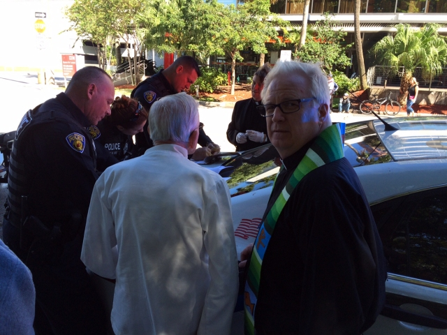 Fort Lauderdale, Florida police have arrested an Episcopal priest, the Rev. Canon Mark K. Sims, (foreground, in green stole), rector of St. Mary Magdalene, Coral Springs, for violating a new local ordinance prohibiting anyone from feeding the poor and homeless in a park. Fr. Sims has led efforts to feed the poor for 20 years, but it's winter now and those without shelter gravitate to Florida; Fort Lauderdale attracts tourists and doesn't want homeless people seen in public. (via Episcopal News Service)
