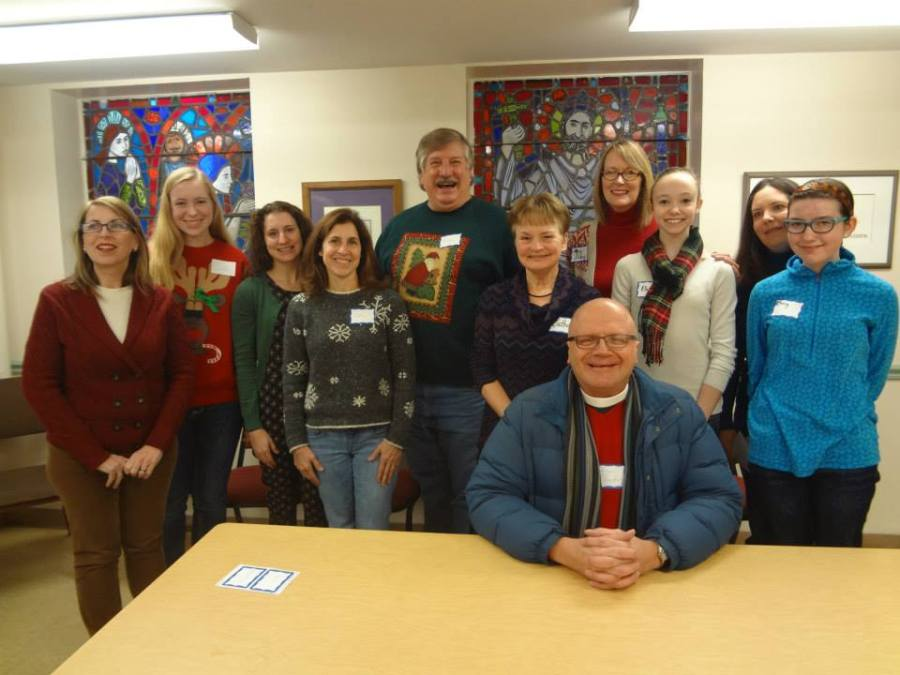 Members of the Chapel of the Good Shepherd, the Episcopal campus ministry at Purdue University in West Lafayette, Indiana, crossed the Wabash River to my home parish, St. John's, Lafayette, last Saturday to help with Jubilee Christmas, a citywide program by Lafayette Urban Ministries which enables low-income parents to shop for Christmas presents for their kids. St. John's and Good Shepherd helped 41 families with 103 kids, while LUM's citywide effort at 55 other churches and Purdue fraternities benefited 600 families and 1600 kids. An hour or two later this room where the Rev. Peter Bunder was doing his bishop impersonation (he's just wearing a red sweater) was transformed into the St. John's/LUM Food Pantry, where I got to help out again. (Good Shepherd on Facebook)