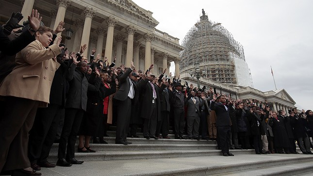 About a hundred Congressional staff members walked off the job Thursday, despite the year-end legislative frenzy on Capitol Hill, and put their hands up to protest the recent deaths of Michael Brown, Eric Garner and other young, unarmed Black men at the hands of police. (Greg Nash/The Hill)