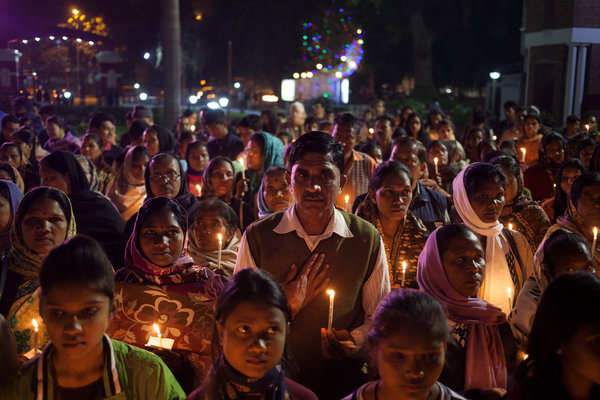 """Before we get caught up in the day we have planned for ourselves, let's stop and consider the plight of religious minorities in India with its new Hindu nationalist government. The prime minister Narendra Modi is silent amid calls for the """"reconversion"""" of minorities, including forcing 200 Muslims in Agra to renounce their faith last April and a plan to force thousands of Christians to become Hindus on Christmas Day. Above, Christians at a vigil after a church was burned down in New Delhi. (Tsering Topgyala/Associated Press)"""