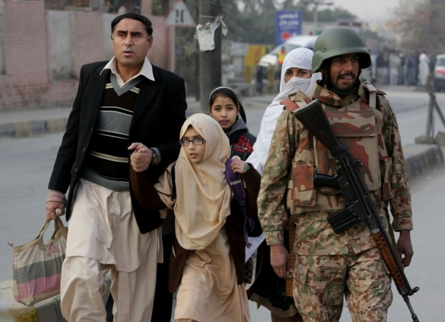 Children escorted after their school was attacked yesterday in Peshawar, Pakistan; 132 kids were killed, plus 9 adults. But this is only the worst of 1000 school attacks in Pakistan since 2009. (B.K. Bangash/Associated Press)