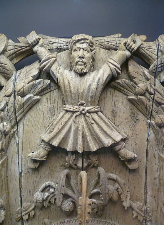 A 16th century woodcarving of the coat of arms of St. Andrews, Scotland. There is something shocking about this, the way the Apostle stares almost straight on at the viewer and how wide his arms and legs are spread out. Certainly this conveys more suffering and pain. The tradition that Andrew was crucified on an X-shaped cross is very old, but it is only tradition; we have no evidence of it. It's fair to infer that the shape, known worldwide as St. Andrew's Cross, is meant to convey a special significance to him as the first follower of Jesus. (Kim Traynor)