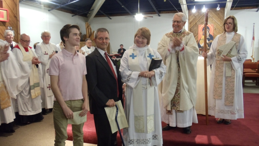 The Rev. Amy Peden Haynie was installed last Sunday as priest-in-charge of the Episcopal Church of Wichita Falls, Texas, in the Diocese of Fort Worth, and she's seen here with son Ben and husband David. Don't you love that look between mother and son?