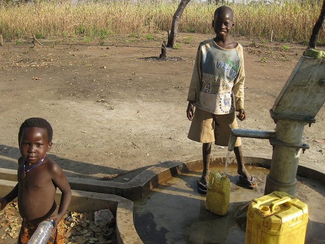 Kids drawing water at a church-built well in the Diocese of Lui, South Sudan, in 2008. After years of war, and now with the country facing famine, we have no way of knowing whether these children are still alive. (Diocese of Missouri)