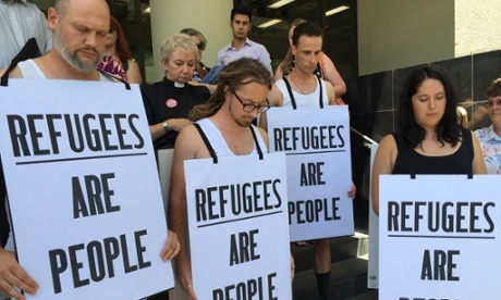 A group of Anglican, United Church and other missionary demonstrators stripped down to their underwear and donned sandwich boards outside a court in Perth, Australia, protesting the continuing detention of 32 asylum-seeking immigrants on Nauru, held since 2011 after being declared security risks by Asio, the government intelligence service. The controversial policy is drawing increasing international scrutiny. (Calla Wahlquist/The Guardian)