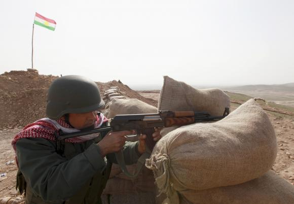A Kurdish Pershmerga fighter poised to engage with ISIS just outside Mosul, Iraq yesterday. The Kurds are trying to cut a key supply route between ISIS-held areas of Syria and Iraq. Meanwhile human rights groups report that ISIS has captured between 90 and 150 Assyrian Christians; let us pray for their safety. (Azad Lashkari/Reuters)
