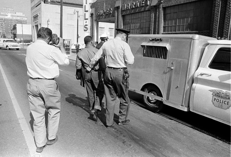 Dr. King, separated from Dr. Abernathy, being led off to jail by the Birmingham Police in 1963. As you can see, King was not a tall man; the officers who confronted him towered high above, so it really wasn't necessary to drag him by his belt loop. (Associated Press)