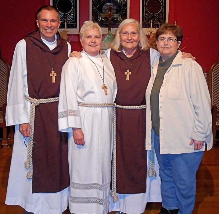 Members of the Community of the Gospel, an American order, showed original photos of the Way of the Cross in Jerusalem last weekend at St. Peter's, Paris, Kentucky. Sr. Julian, second from right, frequents our daily webcasts. (Campbell Welsh)