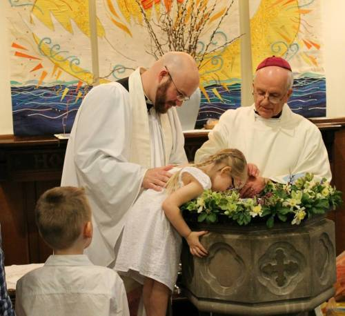 Baptisms last year of siblings Lily and Jack at St. John's, Lafayette, Indiana. (parish photo)