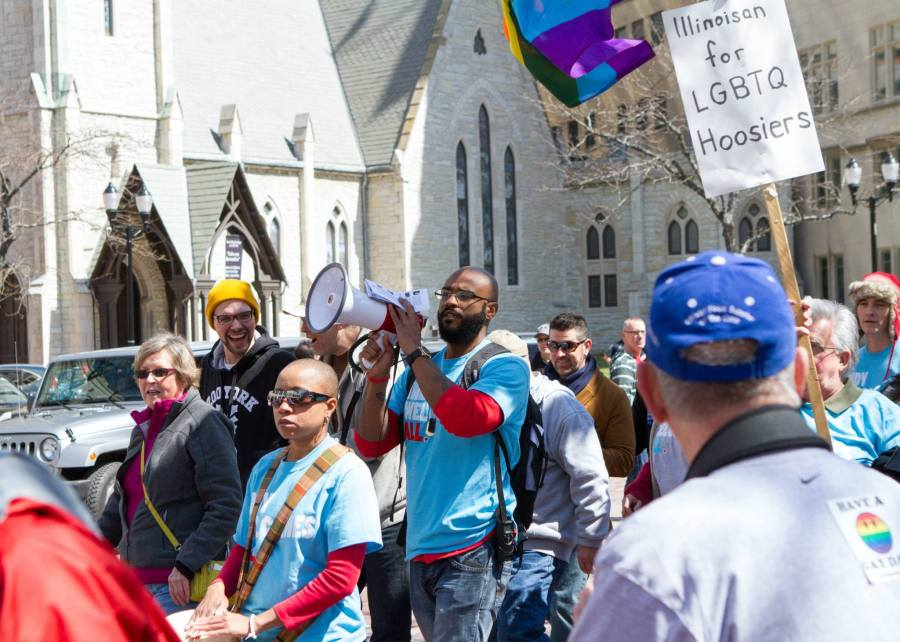 The equality demonstration on April 4 in Indianapolis took place on Monument Circle downtown, right in front of Christ Church Cathedral. Many picketers' signs carried positive Christian messages. (Michael Downey)