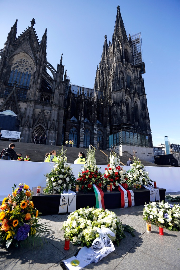 A memorial outside Cologne Cathedral to the victims of the Germanwings plane crash, where the co-pilot decided to kill 150 strangers along with himself. Mental illness had nothing to do with it; he knew it was wrong but he did it anyway. (Frank Augstein)