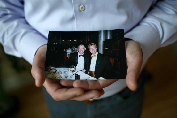 Jim Obergefell holds an old photograph of him and his late husband John Arthur; the two men from Ohio were married in 2013 in Maryland, having flown there in a specially equipped medical plane to wed a few days before John died of ALS, known as Lou Gehrig's Disease. Their home state would not marry them. After John died, Ohio refused to list Jim as his surviving spouse; Jim sued, and that case will be argued before the United States Supreme Court today, in what's expected to be a landmark ruling on whether same-sex marriage is a Constitutional right. (Maddie McGarvey/Washington Post)