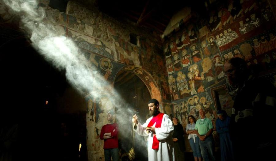 A monk censing at Vespers at Mar Musa Monastery in Nebek, Syria, where Aramaic-speaking Assyrian Christians face exile or death at the hands of Islamic State terrorists. (Ghaith Abdul-Ahad/Getty Images)