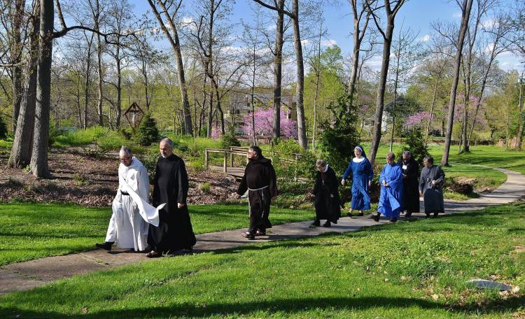 Representatives of the Conference of Anglican Religious Orders in the Americas met at the Transfiguration Spirituality Center in Glendale, Ohio in 2015, making a colorful parade as they walked the grounds in their differing habits. (Community of the Transfiguration)