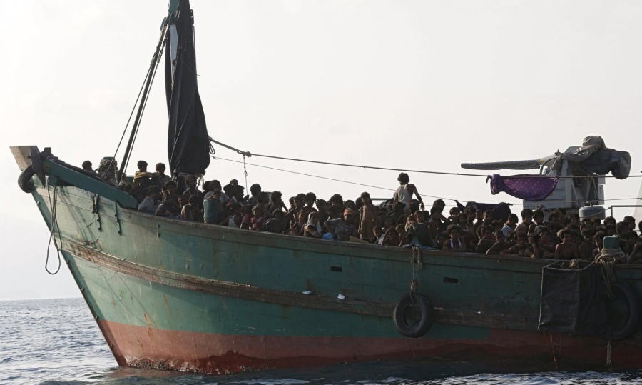 """Rohingyas and Bangladeshis have been stranded for days in the """"floating coffins"""" of human traffickers, fleeing persecution and statelessness in Myanmar, praying for admission somewhere in Asia. Today the Philippines announced it would receive up to 8000 of these Muslim refugees, the first country in the region to open its shores. The news won't be enough to solve the problem, but maybe it will shame other nations in the region into acting instead of pointing fingers. The victims lack food and water. (Olivia Harris)"""