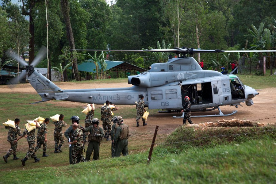 Nepalese service members load relief supplies into a U.S. Marine Corps UH-1Y Venom from Joint Task Force 505 at Sindhuli, Nepal 11 May. The Nepalese government requested assistance after a 7.8 magnitude earthquake struck the country 25 April. The U.S. government ordered JTF 505 to provide unique capabilities to assist Nepal. (U.S. Marine Corps photo by MCIPAC Combat Camera Lance Cpl. Hernan Vidana)