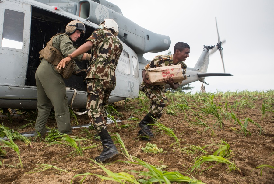 Nepalese army soldiers unload aid and relief supplies, delivered by Joint Task Force 505, from a UH-1Y Venom in the Kavrepalanchowk District, Nepal, May, 11, during Operation Sahayogi Haat.  (U.S. Marine Corps photo by MCIPAC Combat Camera Staff Sgt. Jeffrey D. Anderson)