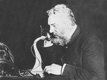 Alexander Graham Bell, demonstrating long distance telephone service between New York and Chicago, 1892.